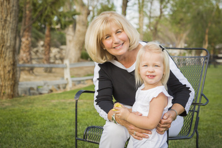 family portrait: Affectionate Grandmother and Granddaughter Playing Outside At The Park. Stock Photo