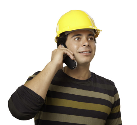 hispanics mexicans: Handsome Hispanic Contractor with Hard Hat Talking on His Cell Phone Isolated on White.
