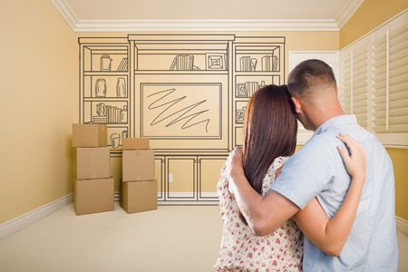 military: Hugging Military Couple In Empty Room with Shelf Design Drawing on Wall.