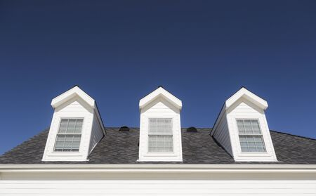 roof windows: Roof of House and Windows Against Beautiful Deep Blue Sky. Stock Photo