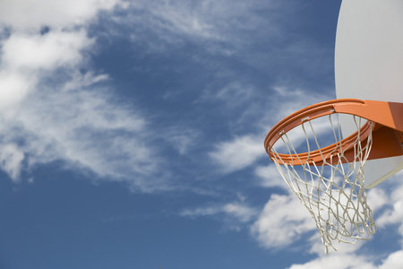 street shots: Abstract of Community Basketball Hoop and Net Against Blue Sky. Stock Photo