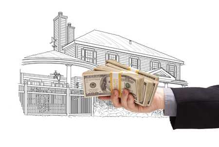 hundreds: Hand Holding Thousands of Dollars In Cash Over House Drawing.