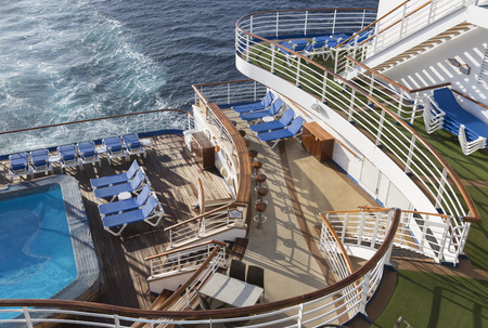 Abstract of Luxury Passenger Cruise Ship Deck, Pool and Chairs.