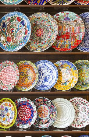 Beautiful Hand Painted Turkish Plates on Shelf at Market.