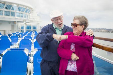 disembarking: Happy Senior Couple Fist Bump on the Deck of a Luxury Passenger Cruise Ship.