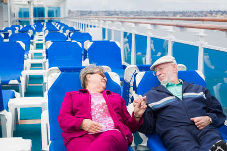 disembarking: Happy Senior Couple Relaxing On The Deck of a Luxury Passenger Cruise Ship.