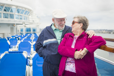 disembarking: Happy Senior Couple Enjoying The View From Deck of a Luxury Passenger Cruise Ship.