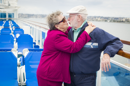 disembarking: Happy Senior Couple Kissing on the Deck of a Luxury Passenger Cruise Ship. Stock Photo