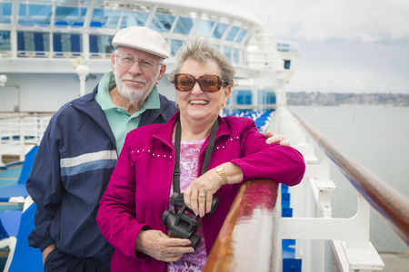 people travelling: Happy Senior Couple Enjoying The View From Deck of a Luxury Passenger Cruise Ship.