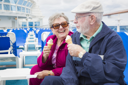 disembarking: Happy Senior Couple Enjoying Ice Cream On The Deck of a Luxury Passenger Cruise Ship.