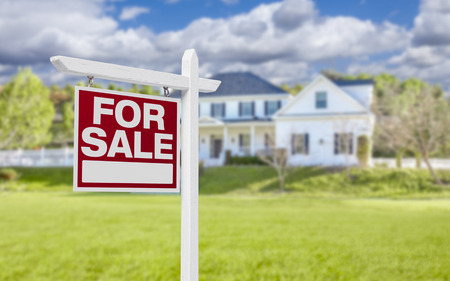 real estate sign: Home For Sale Real Estate Sign in Front of Beautiful New House. Stock Photo