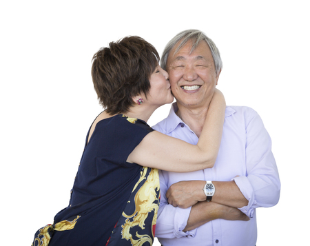 Attractive Affectionate Senior Chinese Couple Isolated on a White Background. Stock Photo
