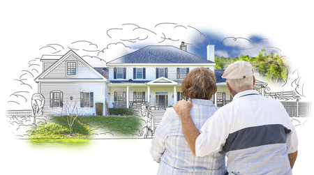 retirement home: Curious Embracing Senior Couple Looking At  House Drawing and Photo Combination on White. Stock Photo
