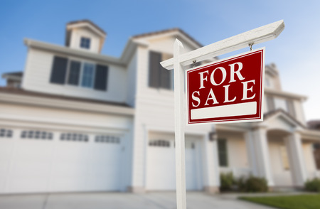 for sale sign: Home For Sale Real Estate Sign in Front of Beautiful New House. Stock Photo