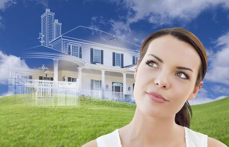 mixed race: Curious Mixed Race Female Looks Over to Ghosted House Drawing, Partial Photo and Rolling Green Hills Behind. Stock Photo