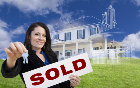 hispanic: Hispanic Woman Holding Keys and Sold Sign with Ghosted House Drawing, Partial Photo and Rolling Green Hills Behind. Stock Photo