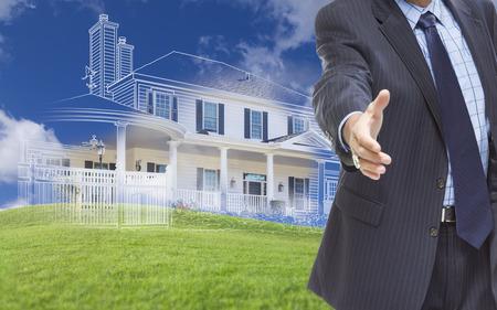 stretta di mano: Maschio mano raggiungendo per stretta di mano con il fantasma Casa disegno, una fotografia parziale e verdi colline dietro. Archivio Fotografico