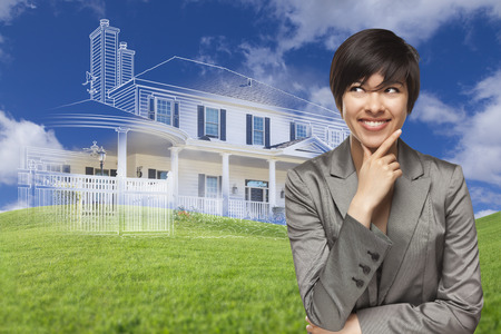 mixed race: Curious, Smiling Mixed Race Woman Looks Over to Ghosted House Drawing, Partial Photo and Rolling Green Hills Behind. Stock Photo