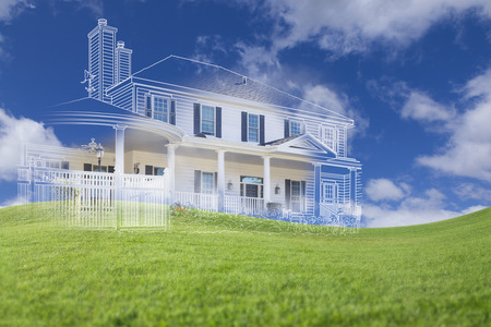 construction plans: Beautiful Custom House Drawing and Ghosted House Above Grass Field. Stock Photo