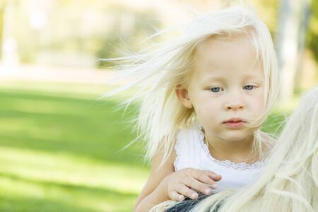 cute little girl: Meloncholy Portrait of Cute Little Girl Outside in Park.