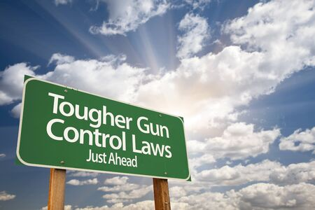 shootings: Tougher Gun Control Laws Green Road Sign With Dramatic Clouds and Sky.