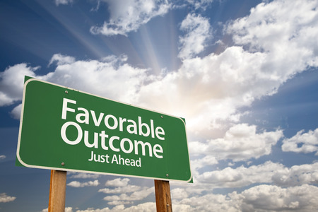 outcome: Favorable Outcome Green Road Sign With Dramatic Clouds and Sky.