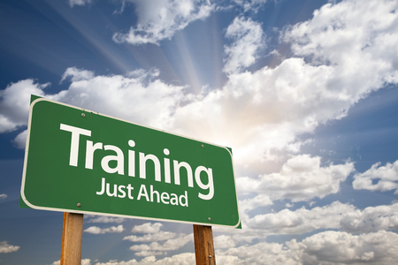 indoctrination: Training Green Road Sign With Dramatic Clouds and Sky. Stock Photo