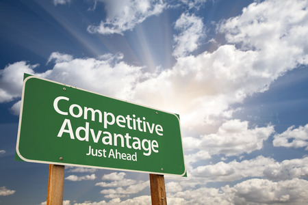 advantages: Competitive Advantage Green Road Sign With Dramatic Clouds and Sky.