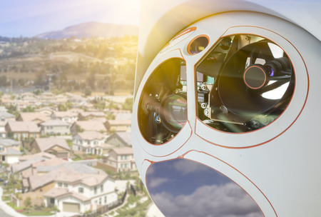 residential neighborhood: Closeup of A Drone Wing Camera and Sensor Pod Module Above A Residential Neighborhood. Stock Photo