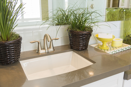 bathroom interior: Beautiful New Modern Bathroom Sink, Faucet, Subway Tiles and Counter.