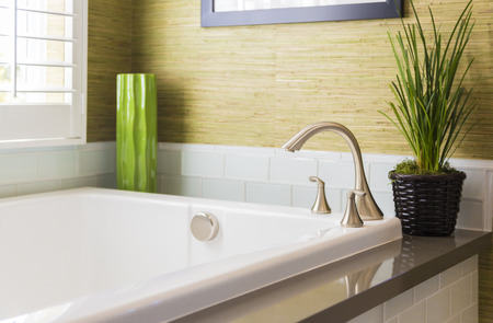 bathtub: Beautiful New Modern Bathtub, Faucet and Subway Tiles.