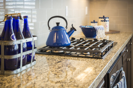 marble: Bautiful Marble Kitchen Counter and Stove With Cobalt Blue Decor.