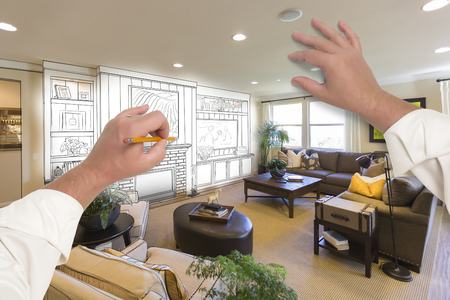 entertainment center: Male Hands Drawing Entertainment Center Unit Over Photo of Beautiful Home Interior.