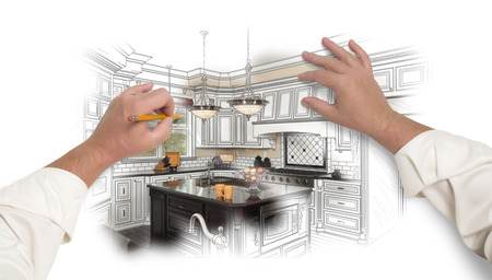 Male Hands Sketching with Pencil A Custom Kitchen with Photo Showing Through. Banco de Imagens