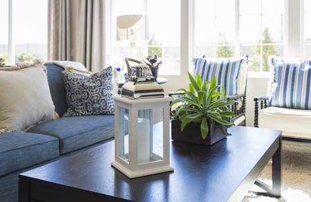 Beautiful Blue Accented Living Area with Coffee Table, Couch and Chairs of Home. Stock Photo