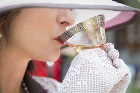 party hat: Pretty 1920s Dressed Girl with Hat, Gloves and Glass of Wine.