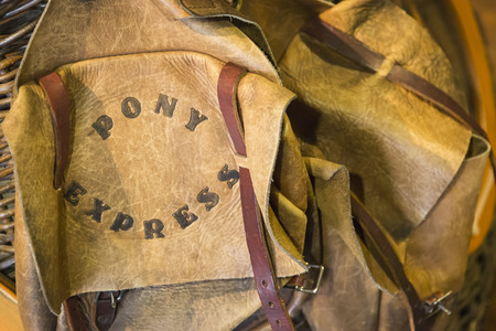 buckled: Vintage Leather Pony Express Saddle Bags Abstract. Stock Photo