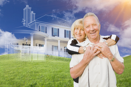 hoping: Senior Couple In Front of Ghosted House Drawing, Partial Photo and Rolling Green Hills Behind. Stock Photo