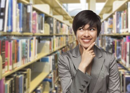 adult student: Curious Mixed Race Girl Looking to the Side in the Library.