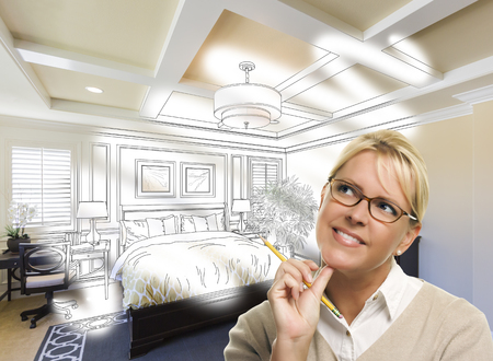Daydreaming Creative Woman With Pencil Over Custom Bedroom Design Drawing and Photo Combination.