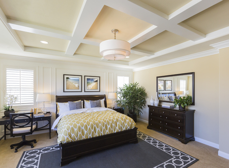 custom home: Dramatic Interior of A Beautiful Master Bedroom. Stock Photo