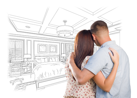 military draft: Curious Young Military Couple Looking Over Custom Bedroom Design Drawing. Stock Photo