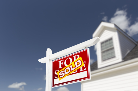 real estate sold: Sold Home For Sale Real Estate Sign in Front of Beautiful New House. Stock Photo