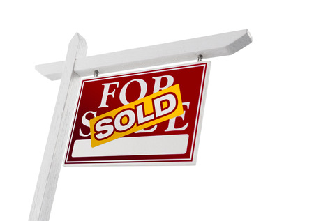 real estate sold: Red Sold For Sale Real Estate Sign Isolated on a White Background. Stock Photo