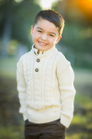 mixed race boy: Handsome Young Mixed Race Boy Portrait Outdoors.