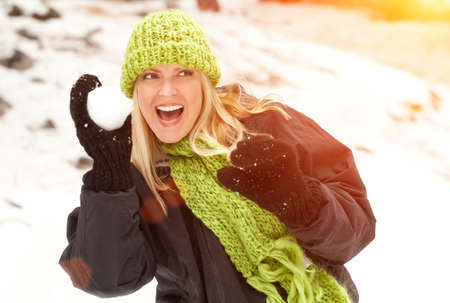 fun day: Attractive Woman Having Fun in the Snow on a Winter Day.