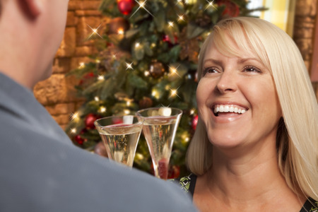 occasion: Pretty Girl Socializing with Champagne Glass At Christmas Party.