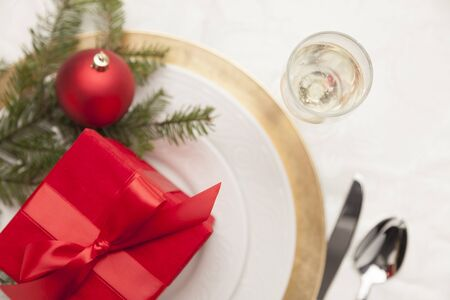 christmas meal: Beautiful Christmas Gift with Place Setting Abstract at Table.