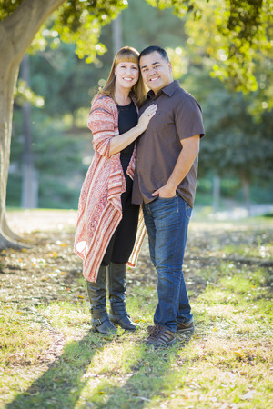 mixed race couple: Young Loving Mixed Race Couple Portrait Outdoors.