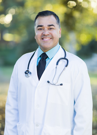 labcoat: Smiling Handsome Hispanic Male Doctor Portrait Outdoors. Stock Photo